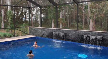 kids swimming in a screen pool enclosure